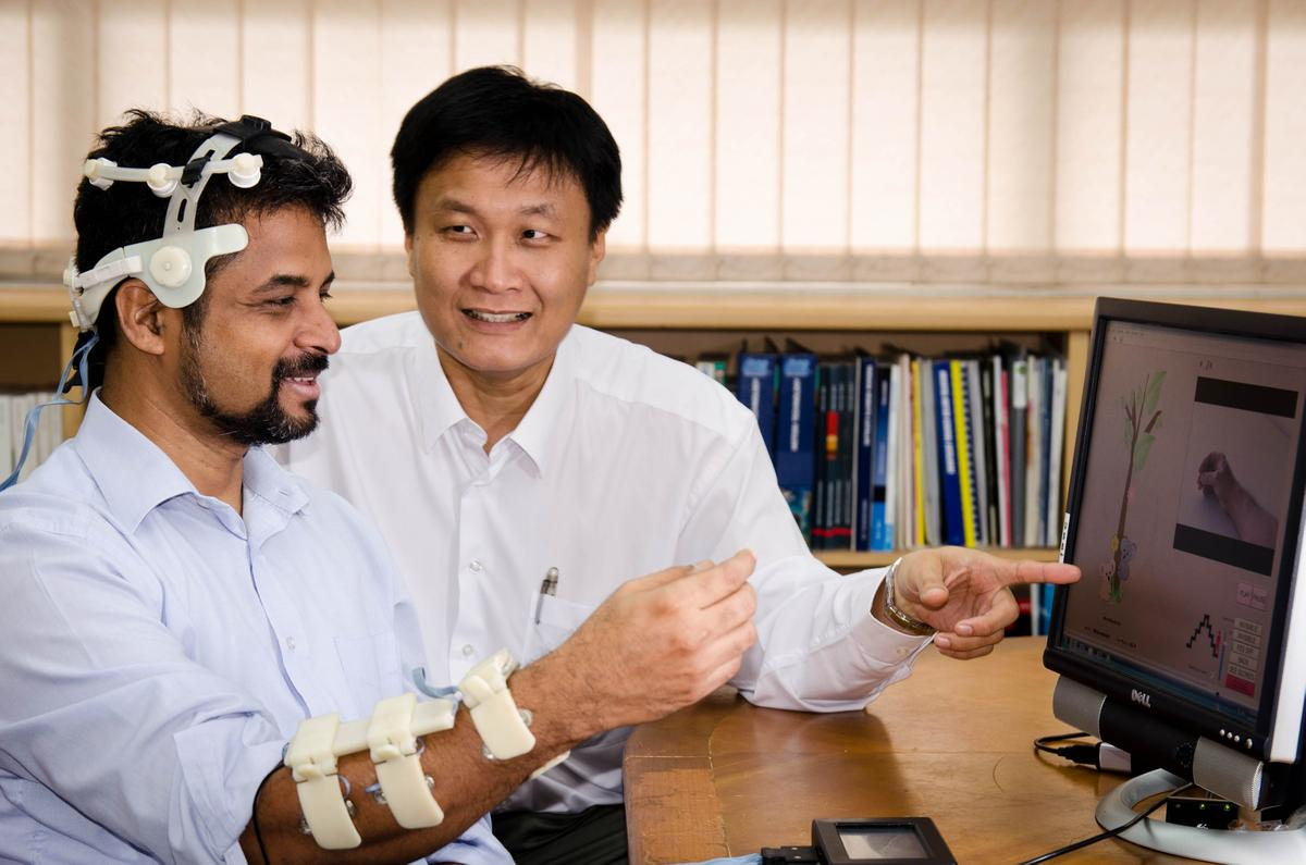 Banerji Subhasis (left) and Dr. John Heng, testing the SynPhNe system