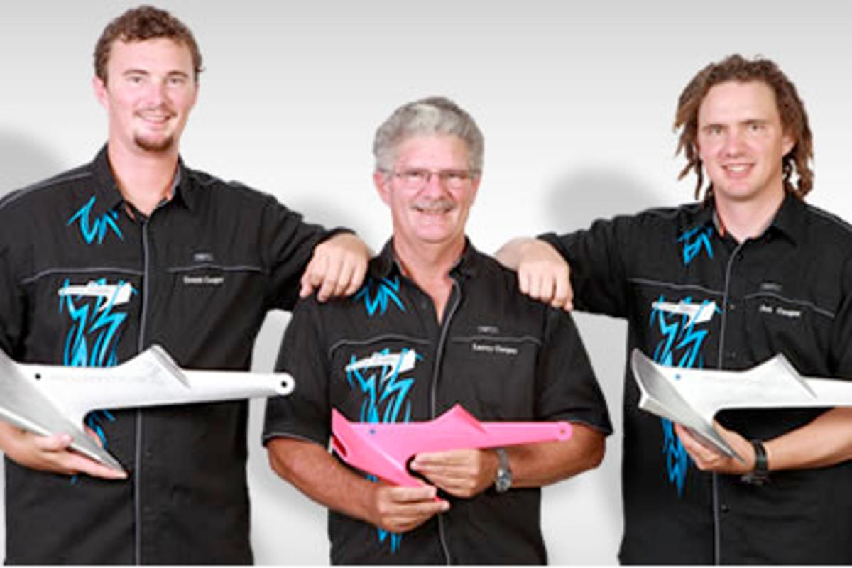 The Cooper Plastic Anchor for small watercraft being held by inventor Larry Cooper in between sons Jon and Grant