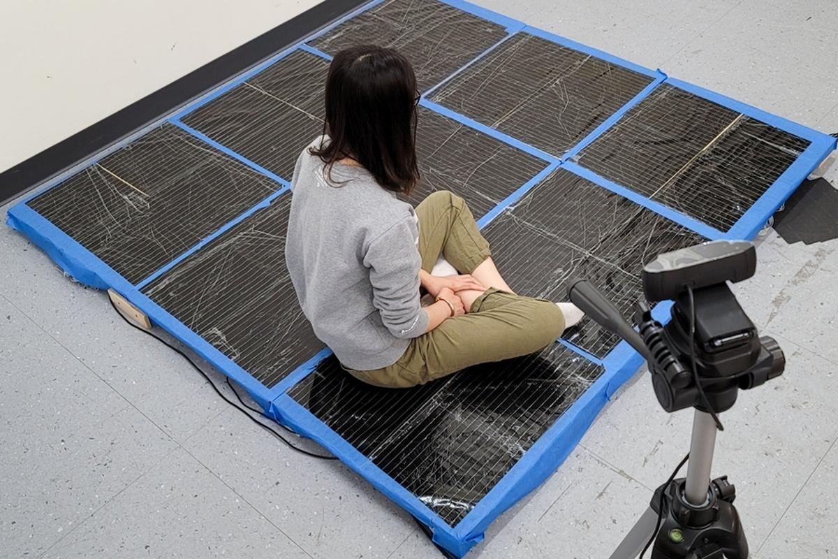 """A new """"smart carpet"""" can sense a person's movements or body pose, which may be useful for exercise or gaming"""
