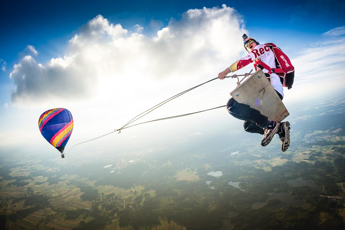 The winner of the Wings category was Philip Platzer of Austria, for this dizzying snap of Marco Fürst at the height of a swing suspended from a hot air balloon, in Fromberg, Austria