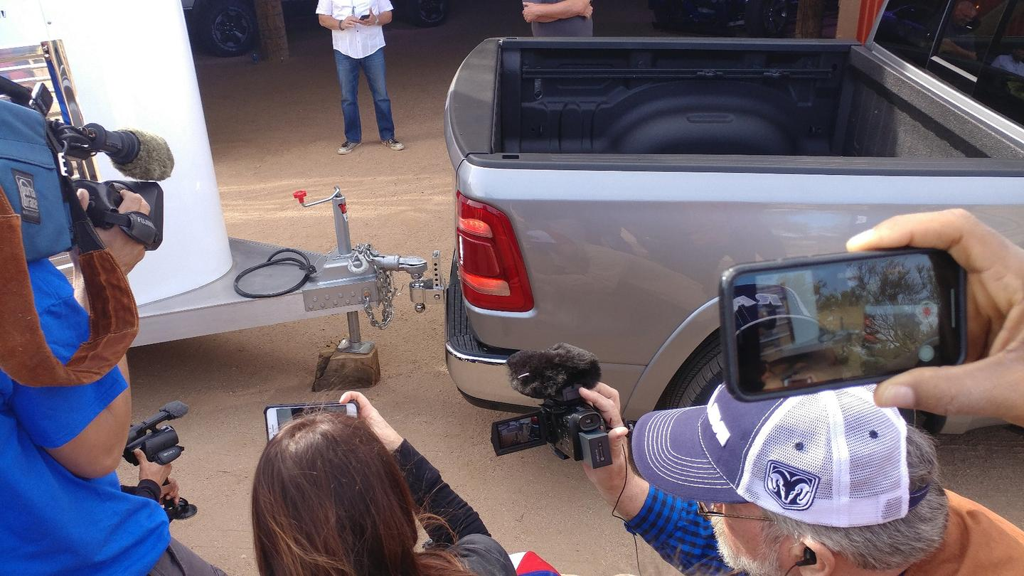 A Ram Truck representative demonstrates using the rearview camera to back up to a trailer, stopping just as the ball reaches the receiver so the air suspension can lift the trailer, leaving the manual work at a minimum