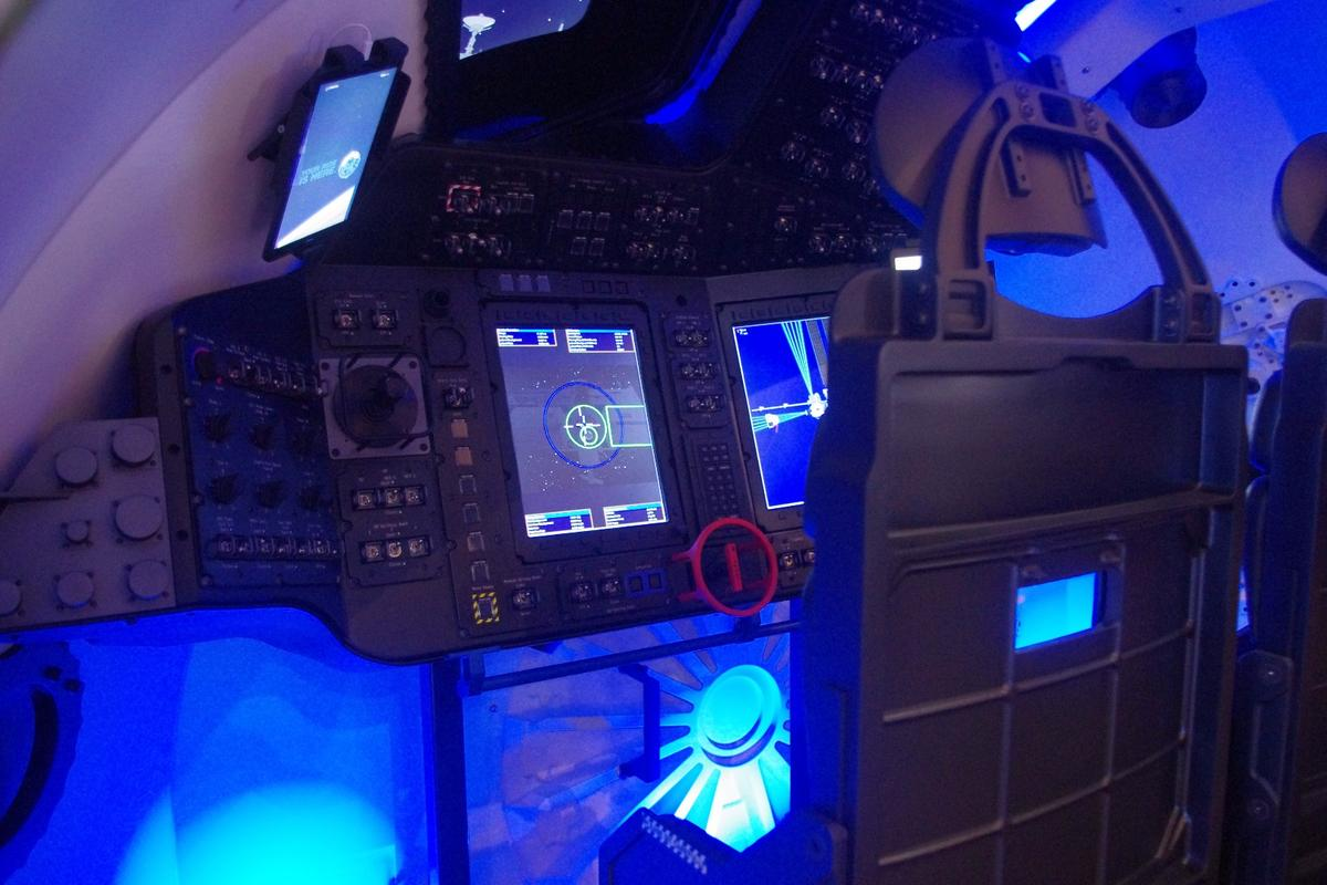 The simulated ride in Boeing's Starliner was controlled through the joystick to the left of the screen