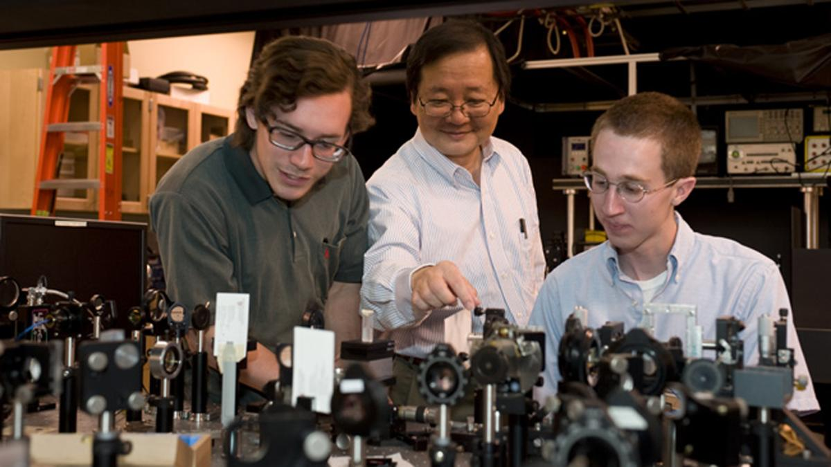 WSU chemist Choong-Shik Yoo, seen here with students, has used super-high pressures to create a compact, never-before-seen material capable of storing vast amounts of energy (Credit: WSU)