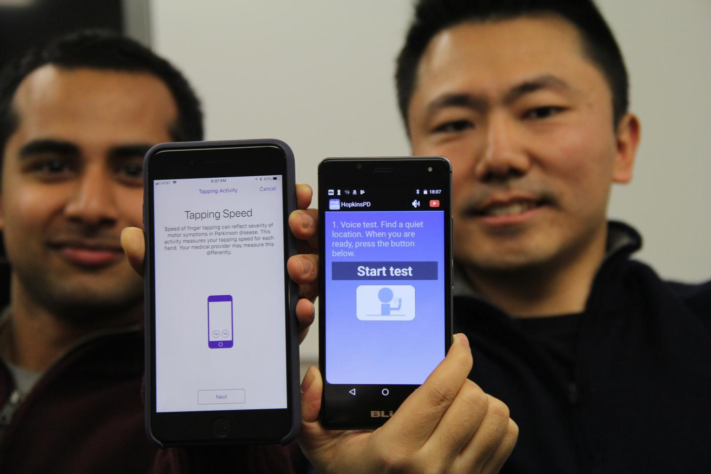Johns Hopkins computer science students Srihari Mohan (left) and Andong Zahn display the iOS and Android versions of the app they helped design