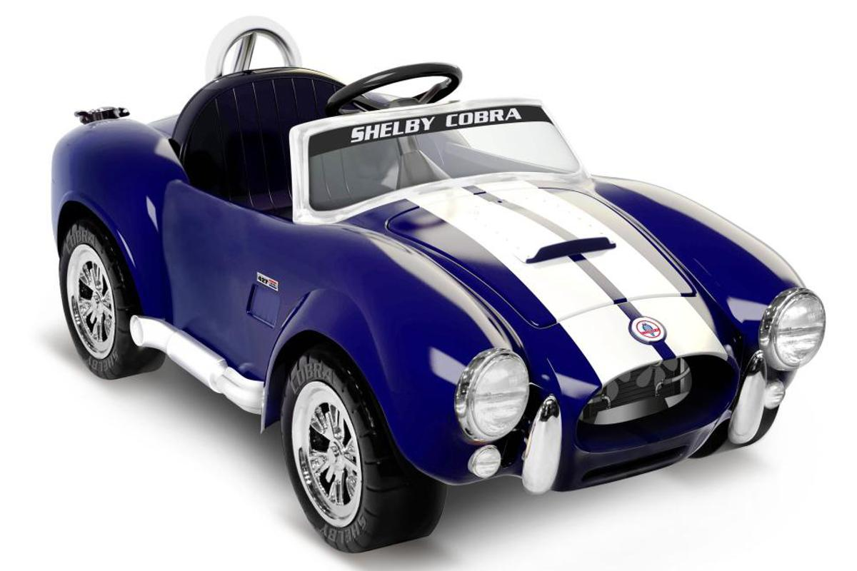 "The Shelby Cobra 427 ""ride on"" travels at speeds of up to 5 mph (8 km/h)"