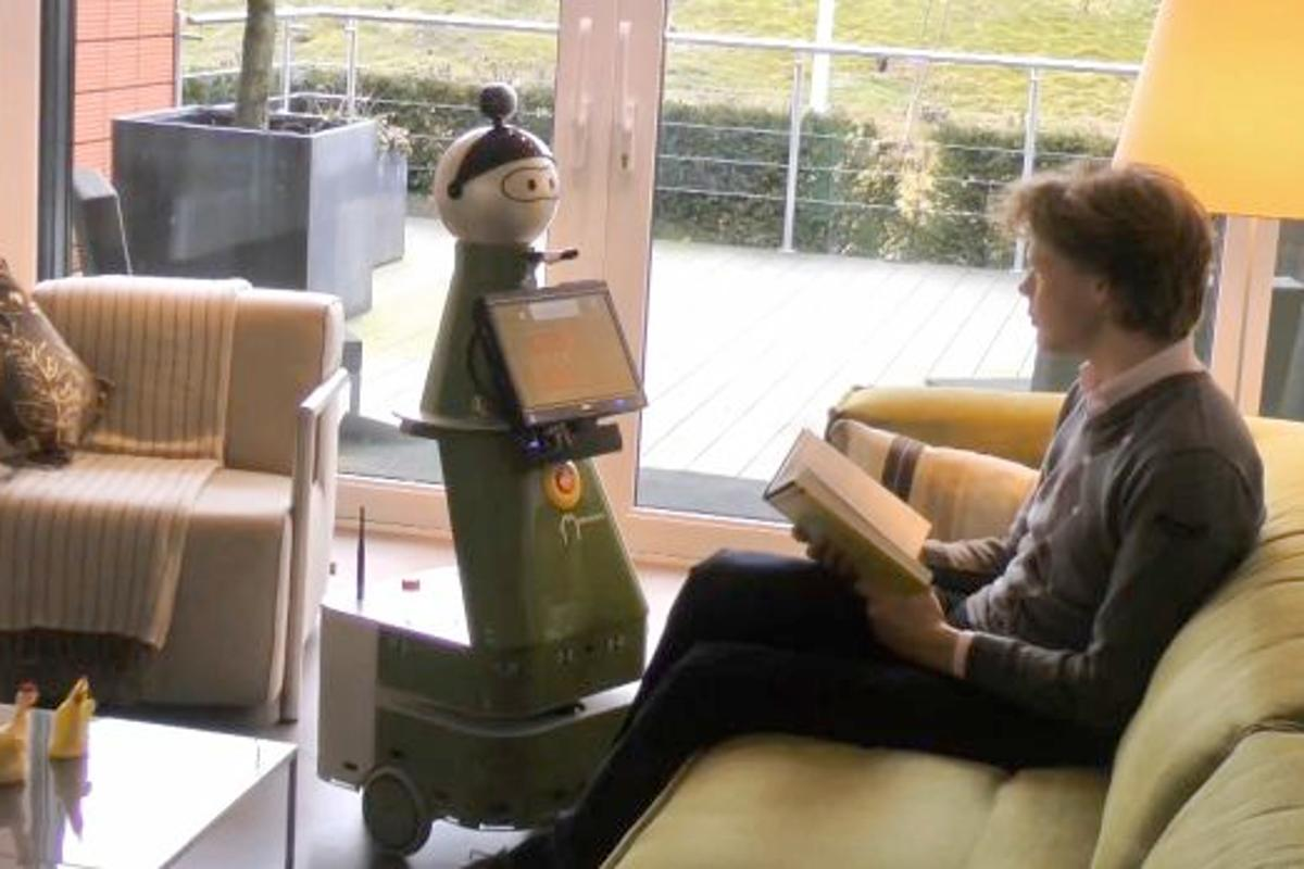 The Mobiserv robot communicates either by two-way audio, or via a touchscreen interface