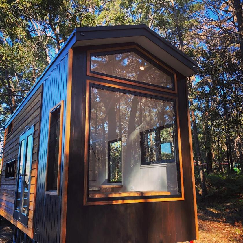 Australian tiny house buildersDesigner Eco Tiny Homes has recently finished a stunning tiny house on wheels that boasts a unique window featurewall