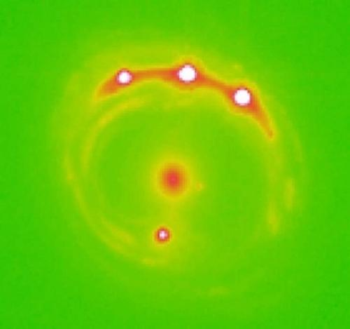 Gravitational microlensing has helped astronomers discover exoplanets beyond the Milky Way