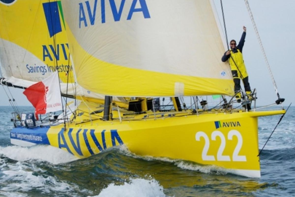 Dee Caffari, onboard Aviva, celebrates as she sets a new world record