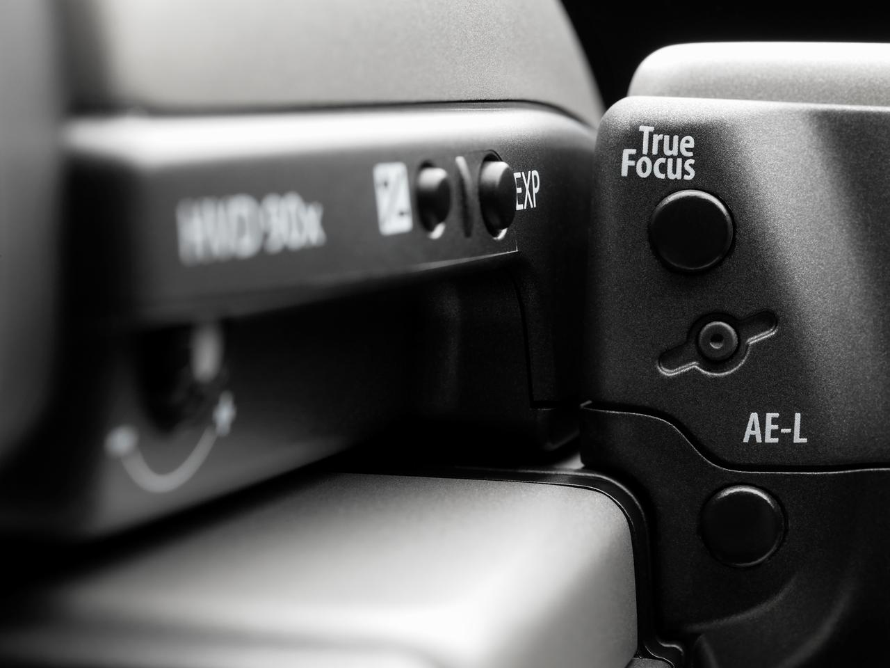 Close up showing the system's True Focus activation button