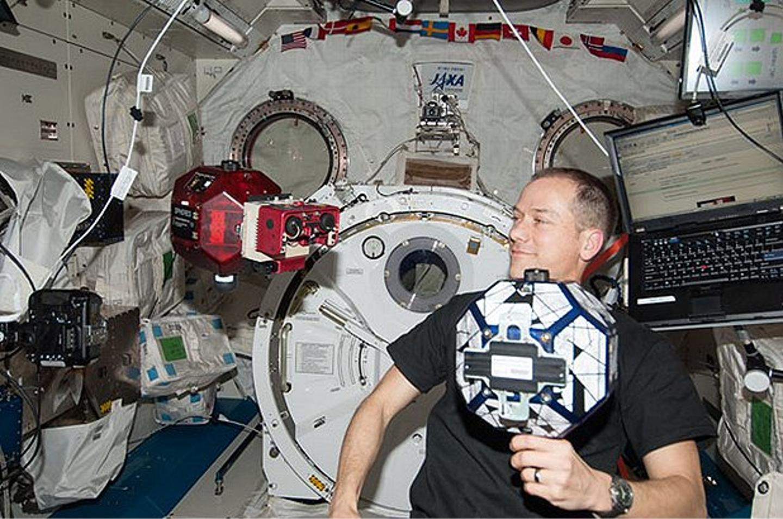 NASA astronaut Tom Marshburn conducts the SPHERES-VERTIGO investigation aboard the International Space Station (Image: NASA)
