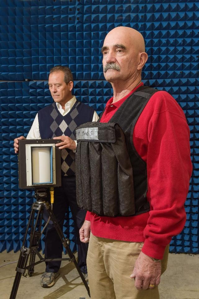 The CBD-1000 bomb detector (left) is trained on a mock suicide vest