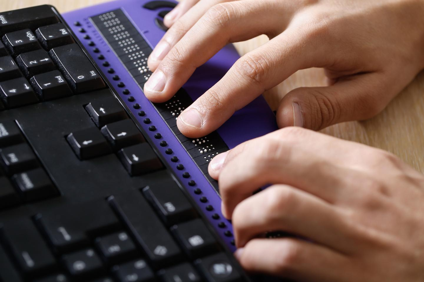 A conventional refreshable braille display, integrated into a keyboard