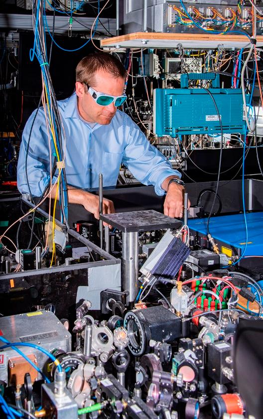 NIST physicist Andrew Ludlow with one of the ytterbium clocks