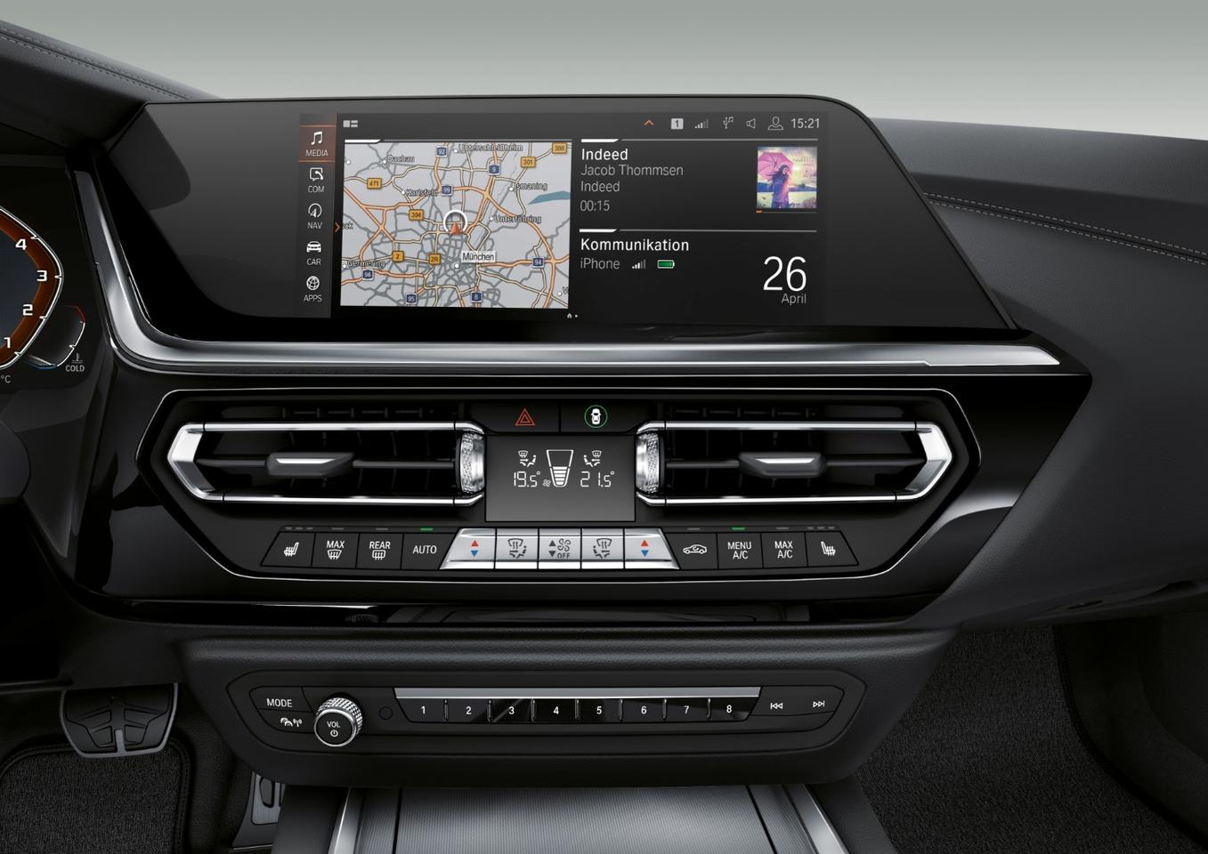 Photos show the large screen integrated into the Z4's dash for infotainment and in-car connectivity