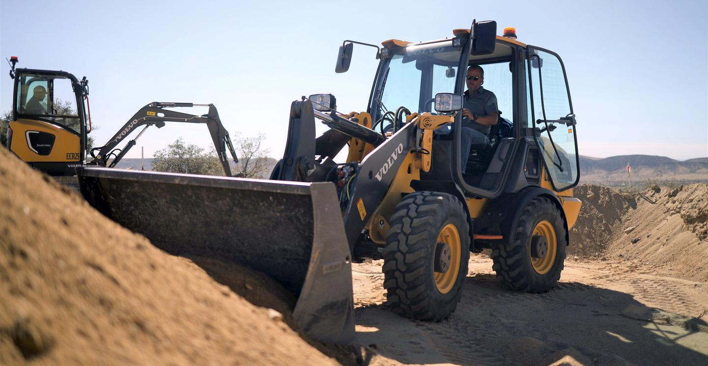 The ECR25 Electric compact excavator (left) and the L25 compact wheel loader (right) are up for pre-order now