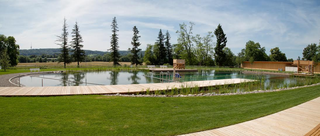 Features include a wading pool for toddlers, a separate pool with a sloping gravel beach, a water-slide, a 25-meter lap pool and a diving board (Photo: Helen Schneider)