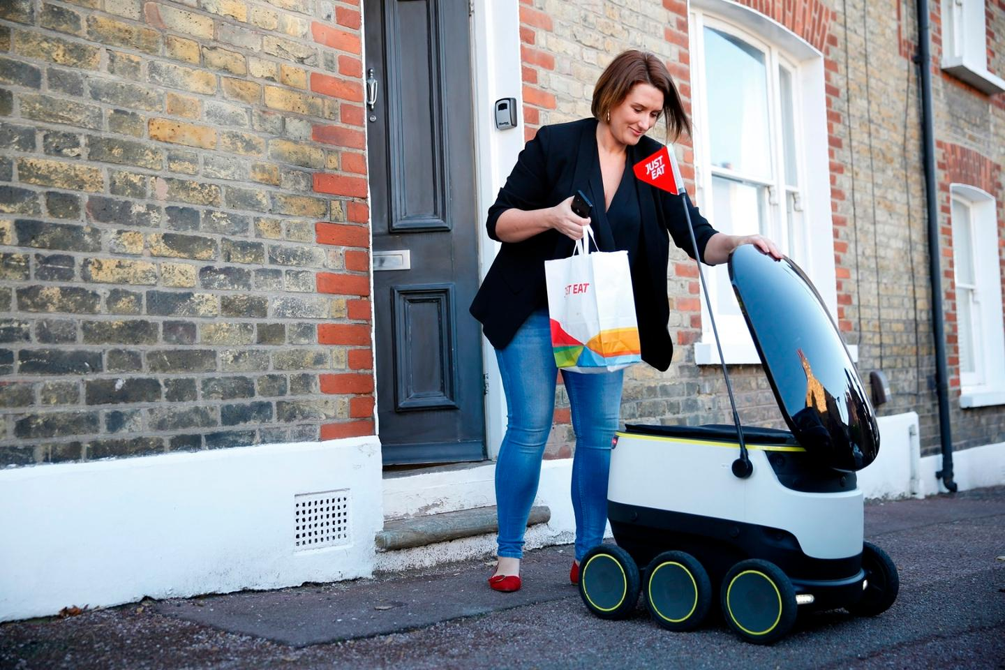 The Just Eat customer who received the robot-delivered order was sent  a unique link for accessing the cargo hold on her phone
