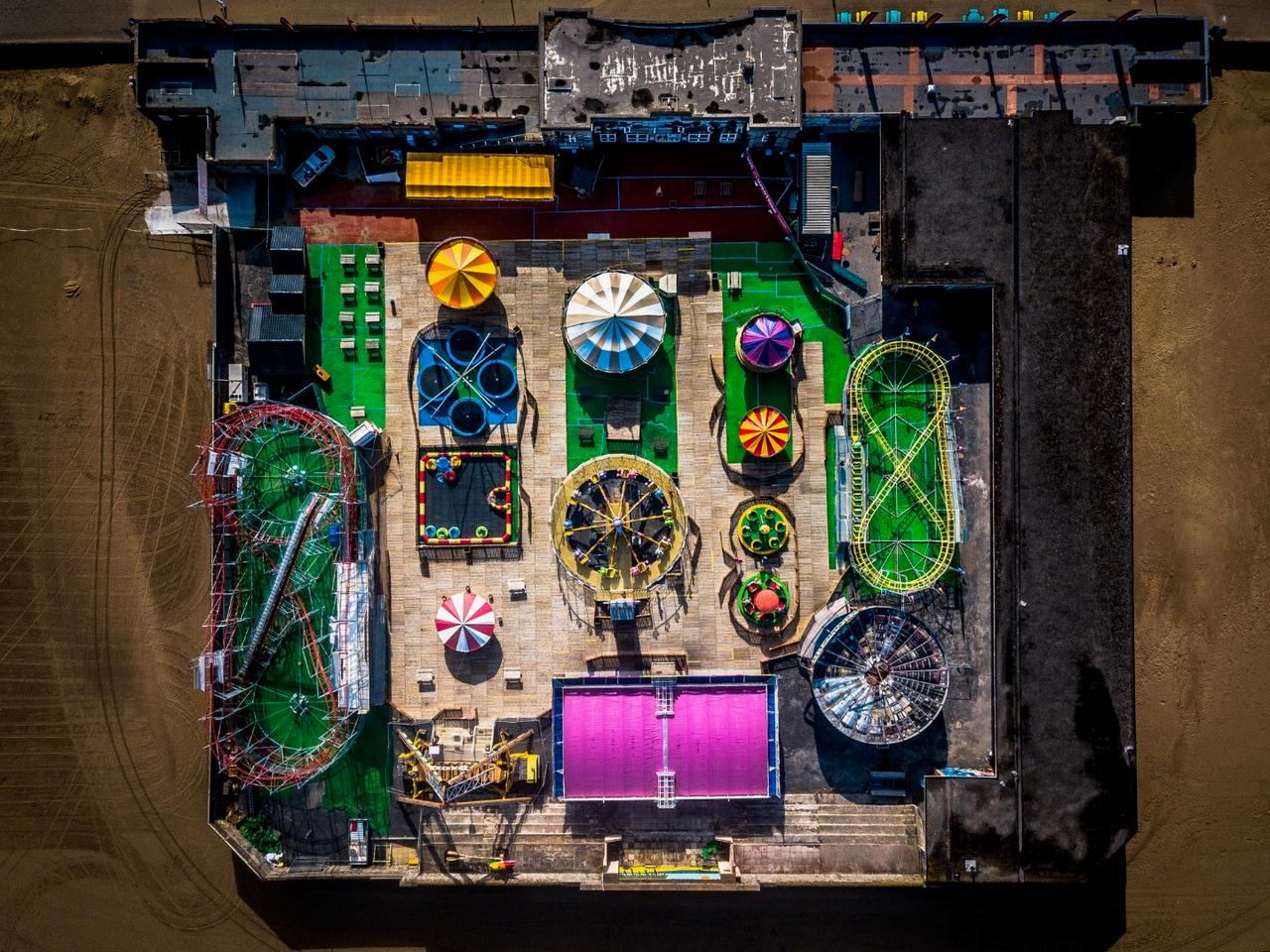 View from above at first glance could be mistaken for a circuit board but this early morning shot of the funfair at Weston Super Mare along the beach