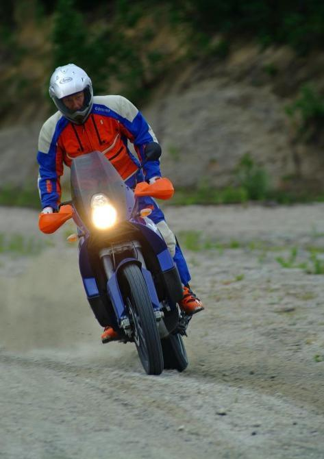 Don't try this at home - not many bikes are capable of getting happily sideways in the dirt and also carrying you across AfricaImage - T. Landrichinger