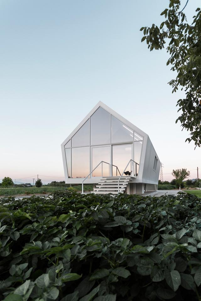 Italian architectural studio LDA.iMdA has recently completed a sustainable compact home that hovers above the ground