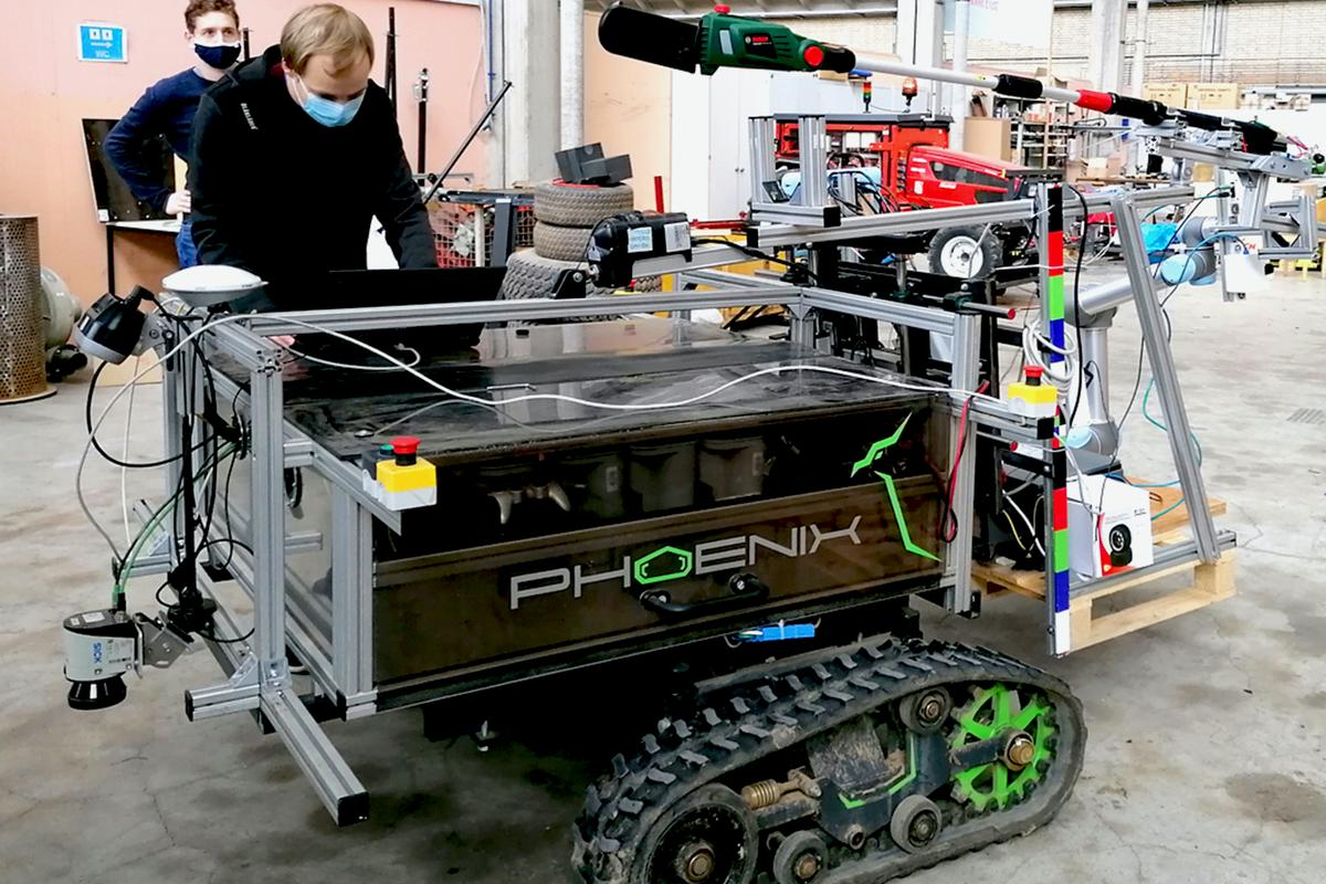 The Phoenix robot, with its arm-mounted sheathed power saw (green) visible at the top of the photo