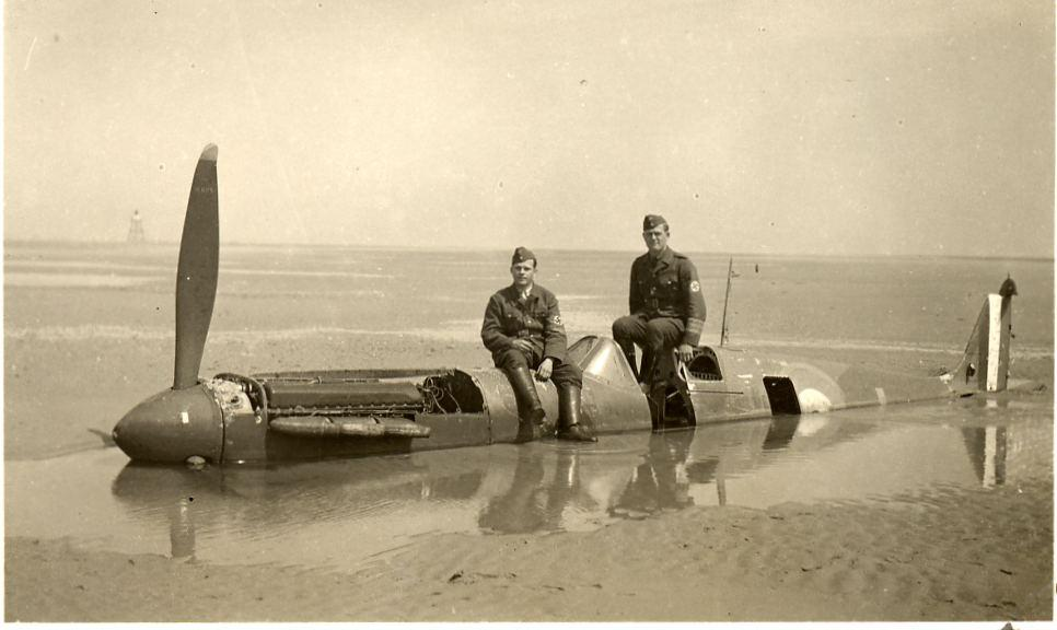German soldiers posed on the Spitfire 9734 when it was forced to land in Calais in 1940
