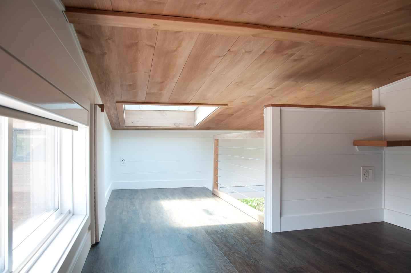The Noyer XL V2's upstairs bedroom is a standard tiny house-style loft bedroom, and includes a skylight