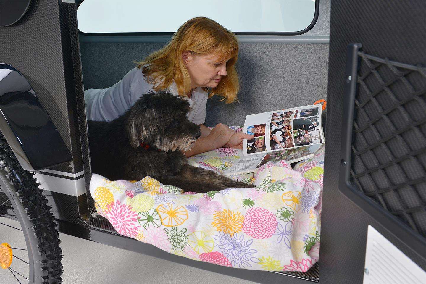It's not a two-person trailer, but maybe a single person + dog?