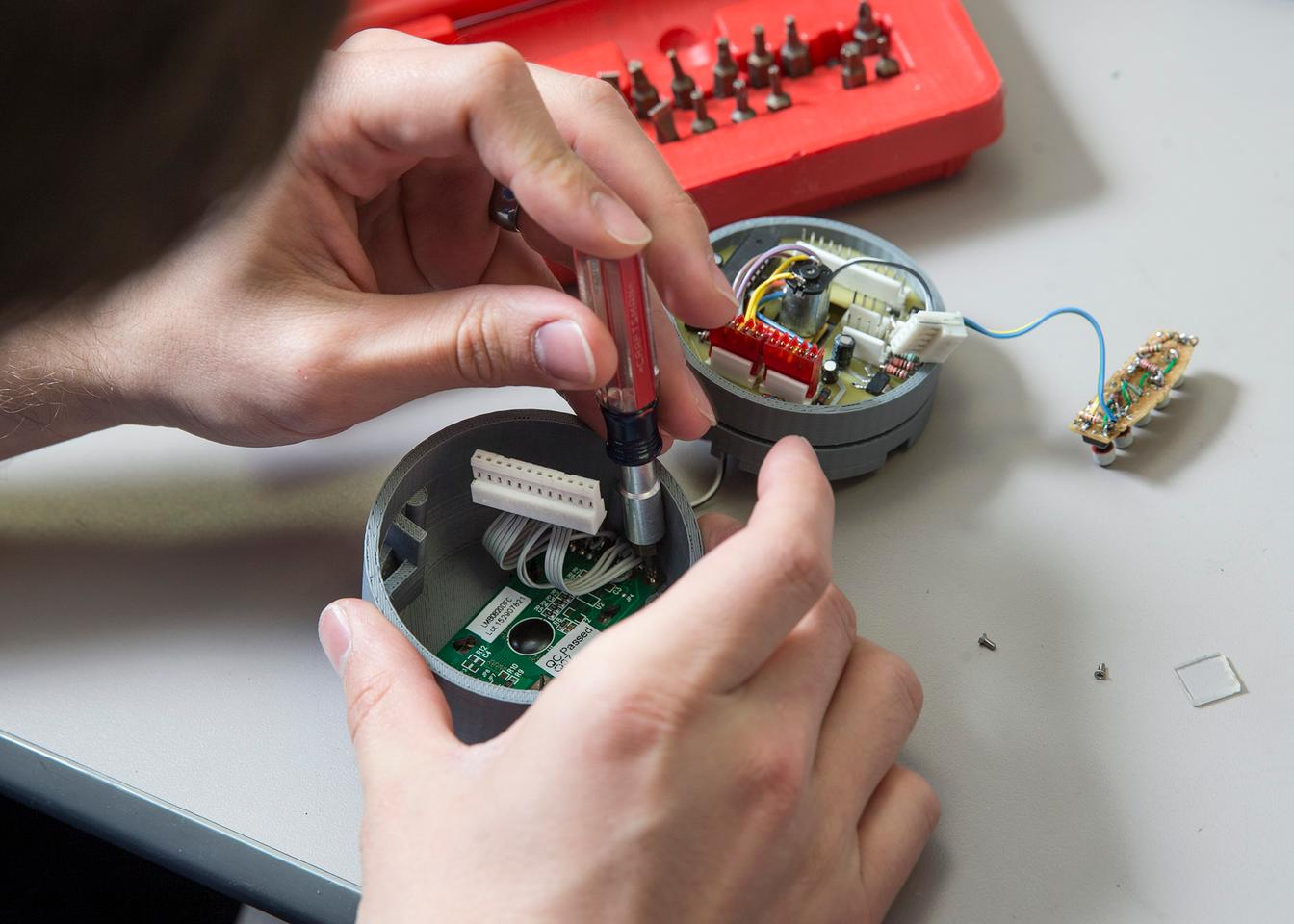 A student works on the Med Vault's electronics