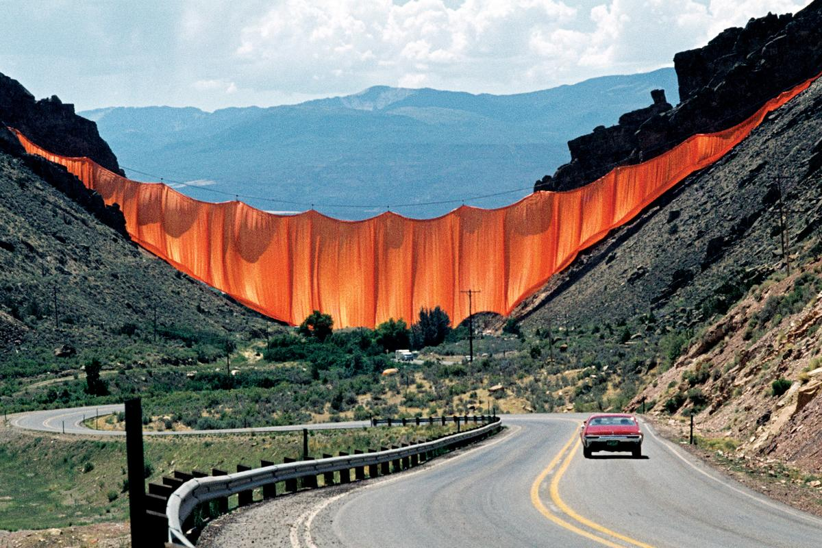 Valley Curtain in Rifle, Colorado, was completed in 1972. The artwork consisted of a 200,200-sq-ft (18,600-sq-m) orange curtain made from woven nylon fabric. It was installed between two Colorado mountain slopes but only stood for 28 hours as high winds made it necessary to remove it