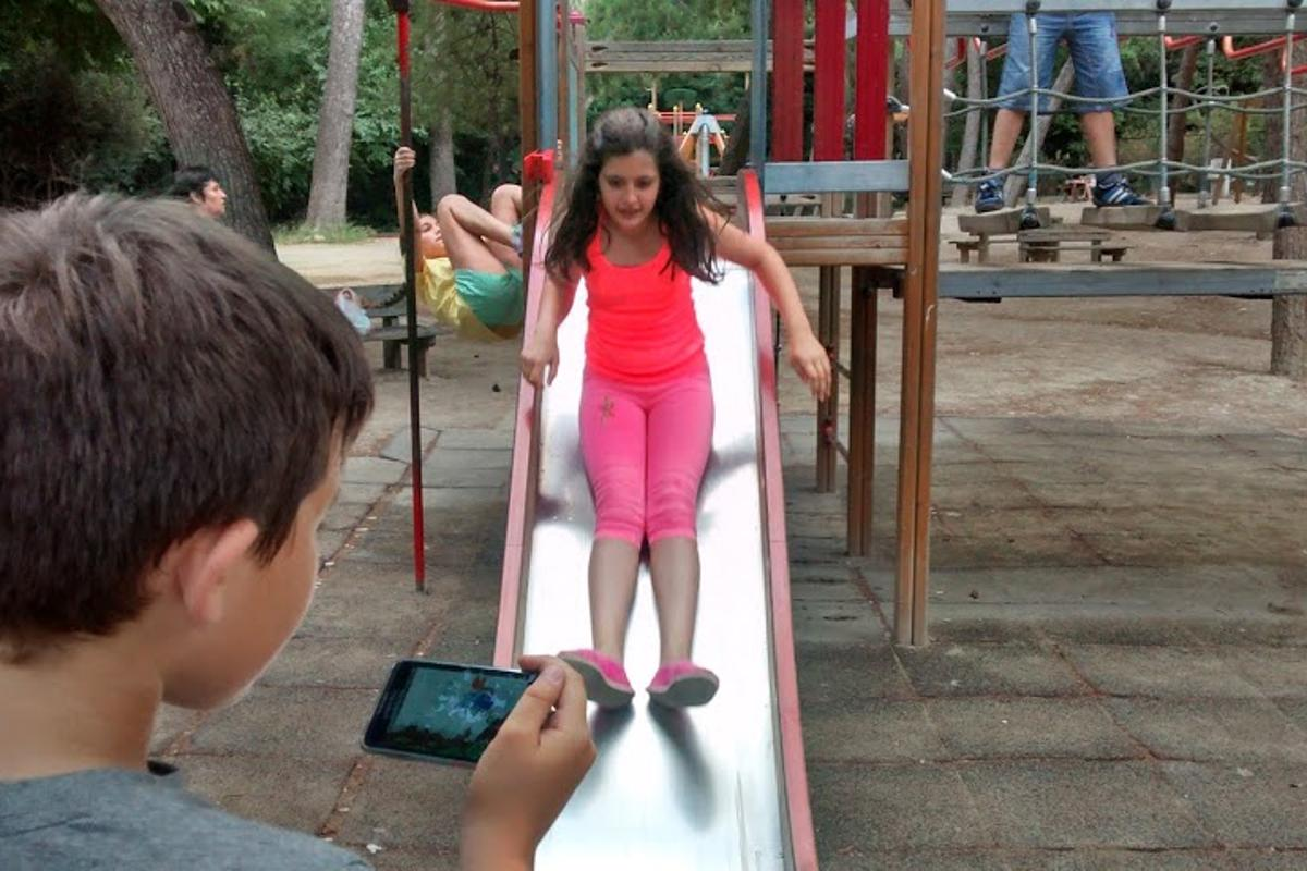 Hybrid Play fuses playground time with mobile games by turning swings and slides into game controllers