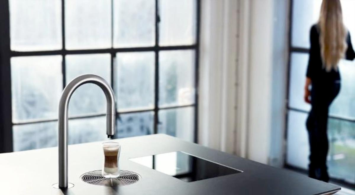 The Top Brewer is a coffee-making system that dispenses brewed-to-order hot beverages from a tabletop tap
