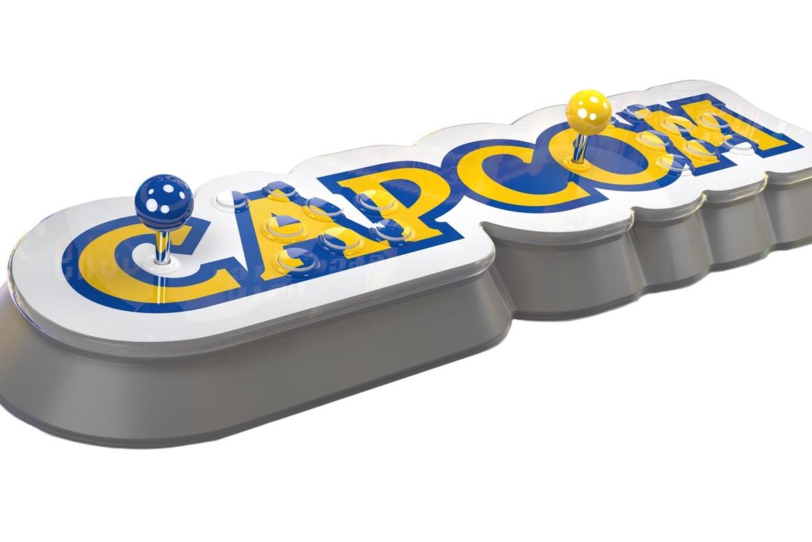 The Capcom Home Arcade is a retro console shaped like the company logo, with two sets of controls on one long panel