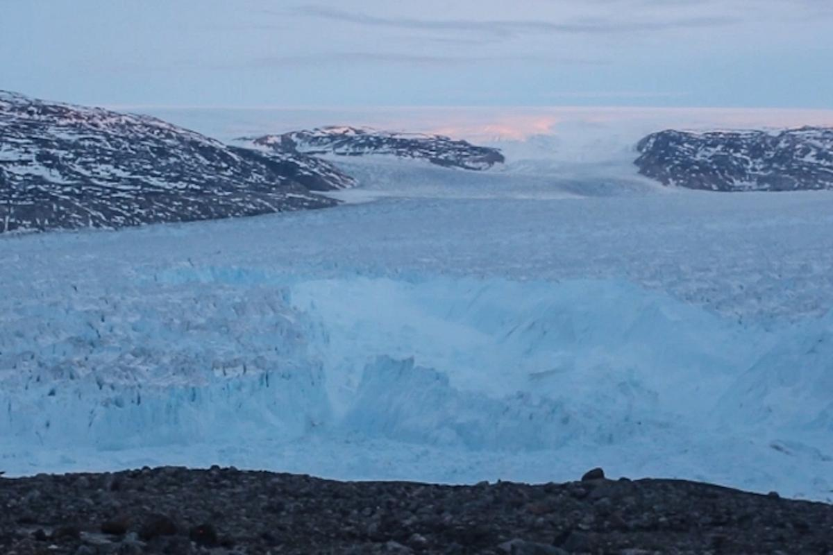 Scientists have captured a four-mile iceberg breaking off the Helheim Glacier in Greenland