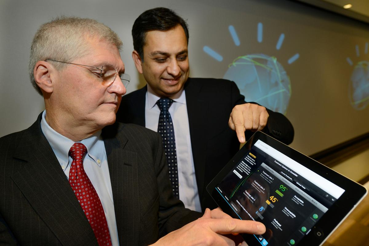 Mark Kris, MD, Chief of Thoracic Oncology, Memorial Sloan-Kettering Cancer Center (left) and Manoj Saxena, IBM General Manager, Watson Solutions (right) work with the first Watson-based cognitive computing solution for oncology (Photo credit: Jon Simon/Feature Photo Service)