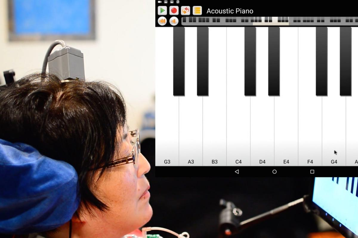 """A test subject uses the BrainGate BCI to play """"Ode to Joy"""" on a virtual keyboard interface"""