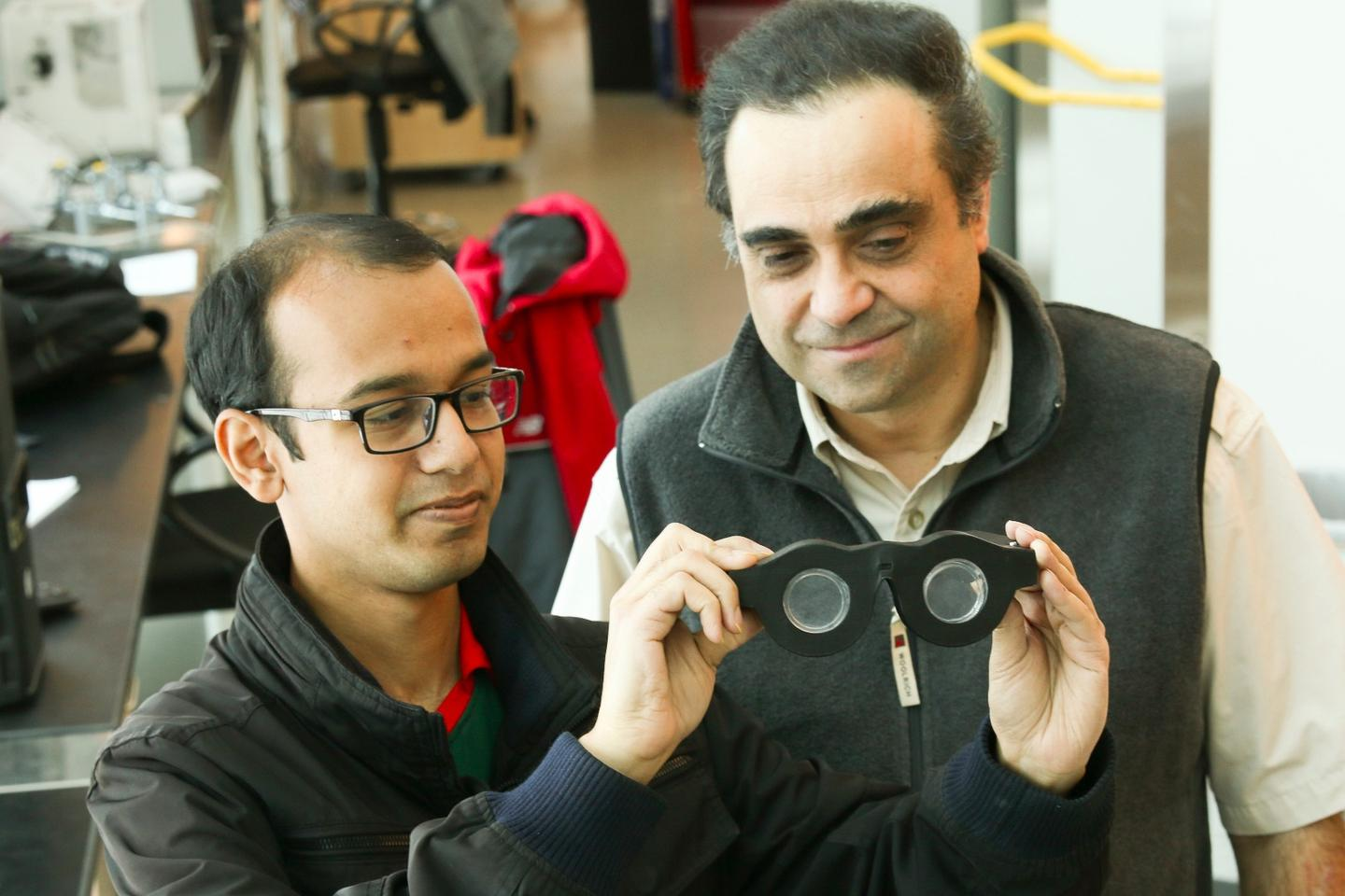 Carlos Mastrangelo (right) and Nazmul Hasan with the prototype glasses