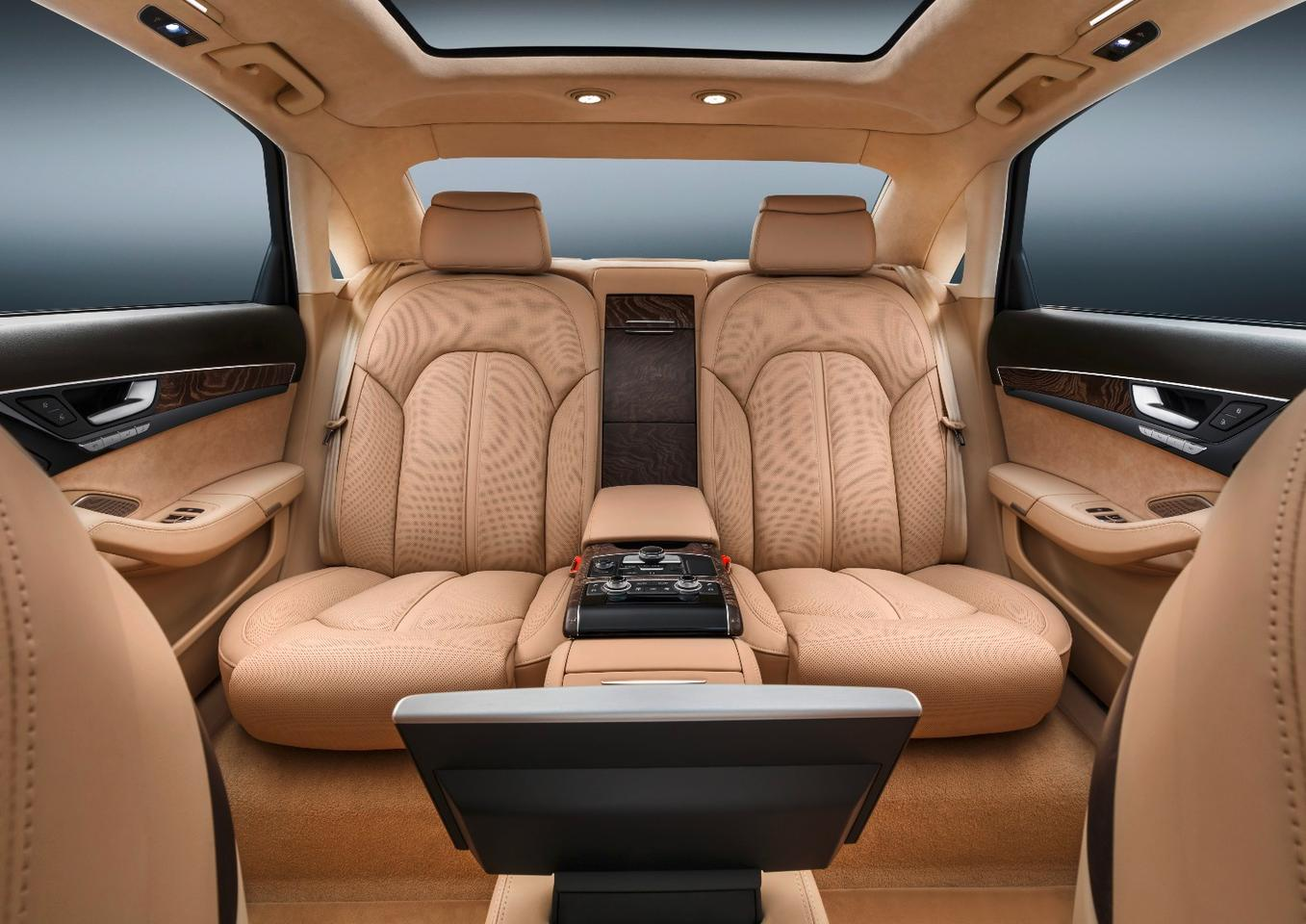 Rear seat passengers are treated to adjustable, supple leather seats