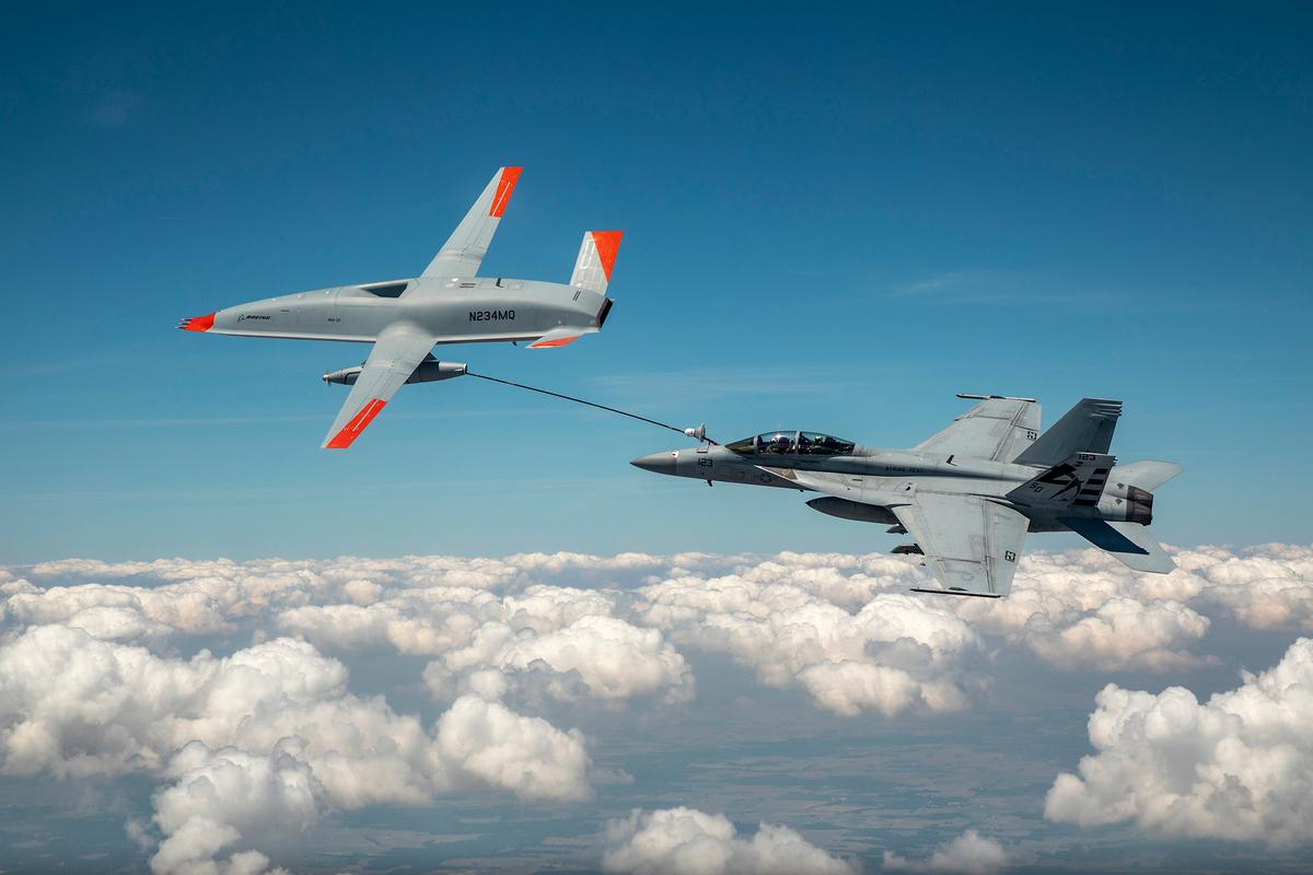 The MQ-25 T1 and the F/A-18 Super Hornet, connected via the drone's fuel hose