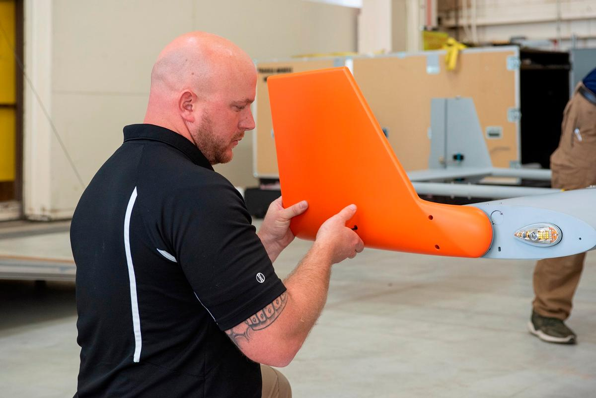 Brad Petty from Navmar Applied Sciences Corporation attaches a winglet to the TigerShark upon arrival at NASA Armstrong Flight Research Center