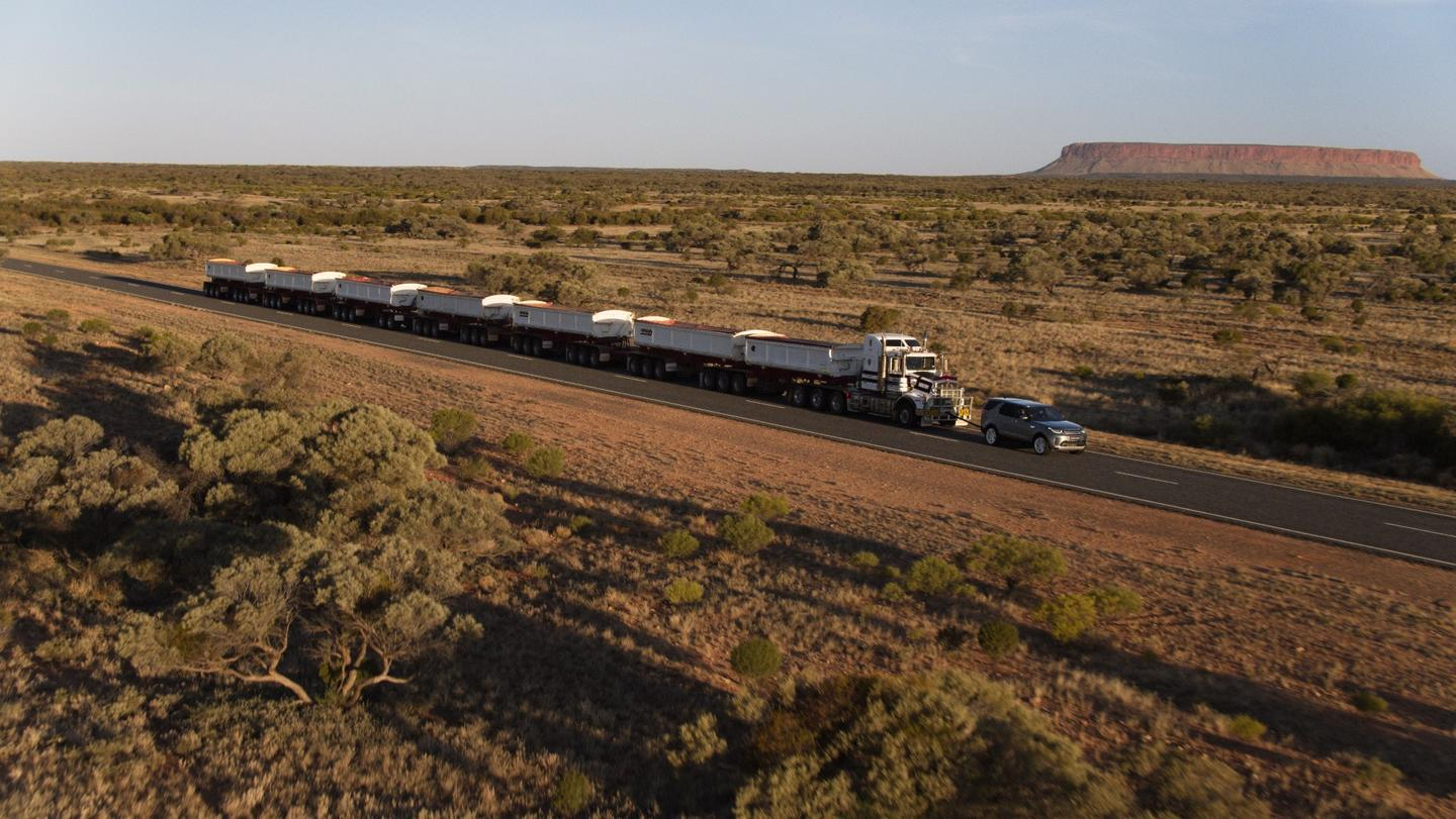 The road train andDiscovery in theAustralian outback