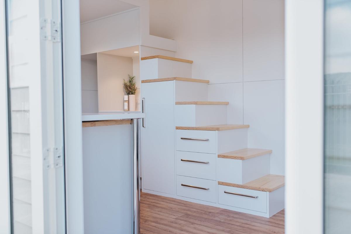 The Dance Tiny House features a storage-integrated staircase (a handrail was installed after the photos were taken)