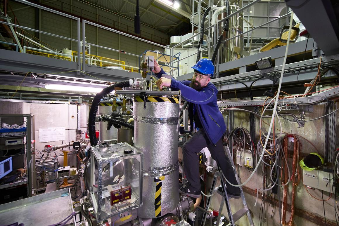 Researcher Stefan Ulmer working on the experiment to hunt for dark matter