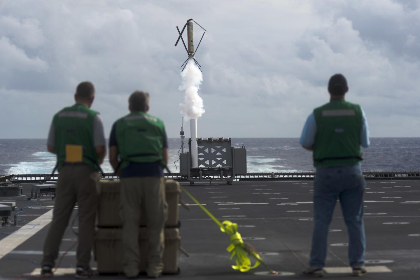 Civilian contractors from the Office of Naval Research conduct a test on the Nomad drone system aboard the littoral combat ship USS Coronado