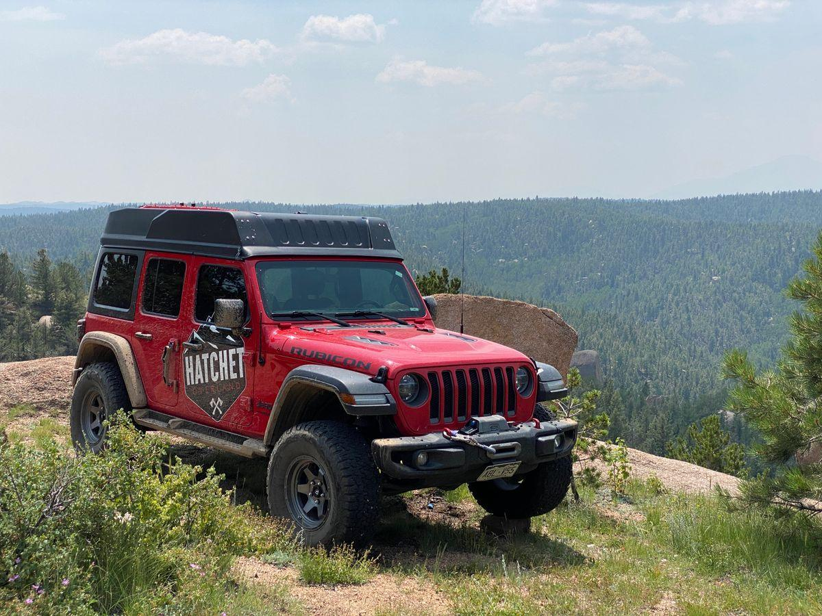 The Hatchet fiberglass top is noticeable on the Wrangler, adding roughly 10 inches to its height