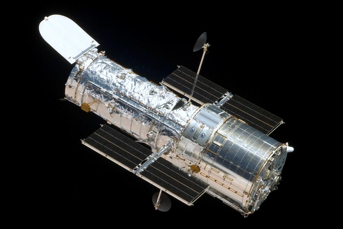 The departing Space Shuttle Atlantis captured this image of the Hubble Space Telescope during a maintenance mission which saw the installation of the Cosmic Origins Spectrograph and the Wide Field Camera 3 (Photo: NASA)