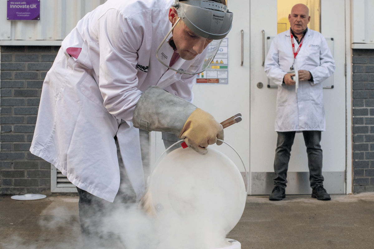 Dr. Thomas Grandjean utilizes liquid nitrogen to freeze a lithium-ion battery