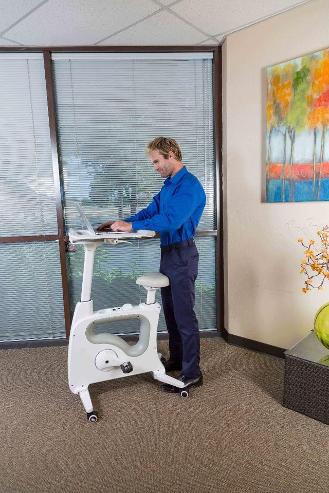 The desktop on the Deskcise Pro can slide back for use as a standing desk