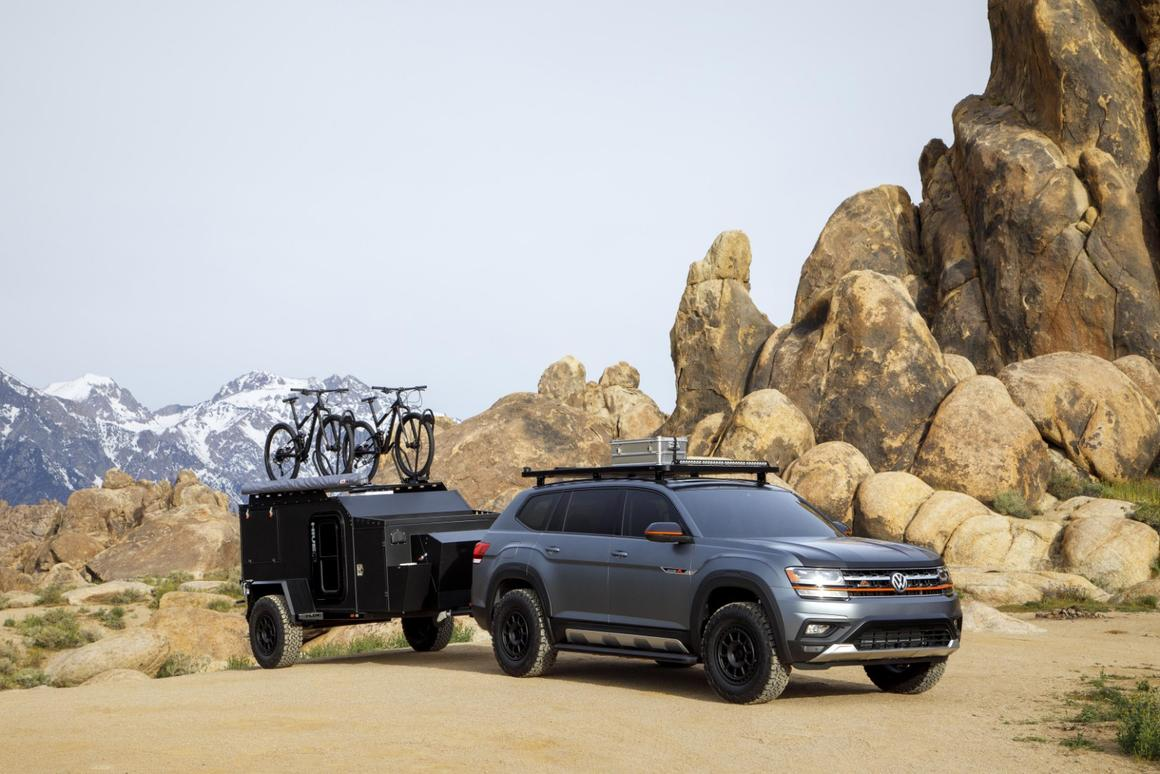 The Atlas Basecamp wears Platinum Gray and Black Uni paint with a matte finish and orange accents